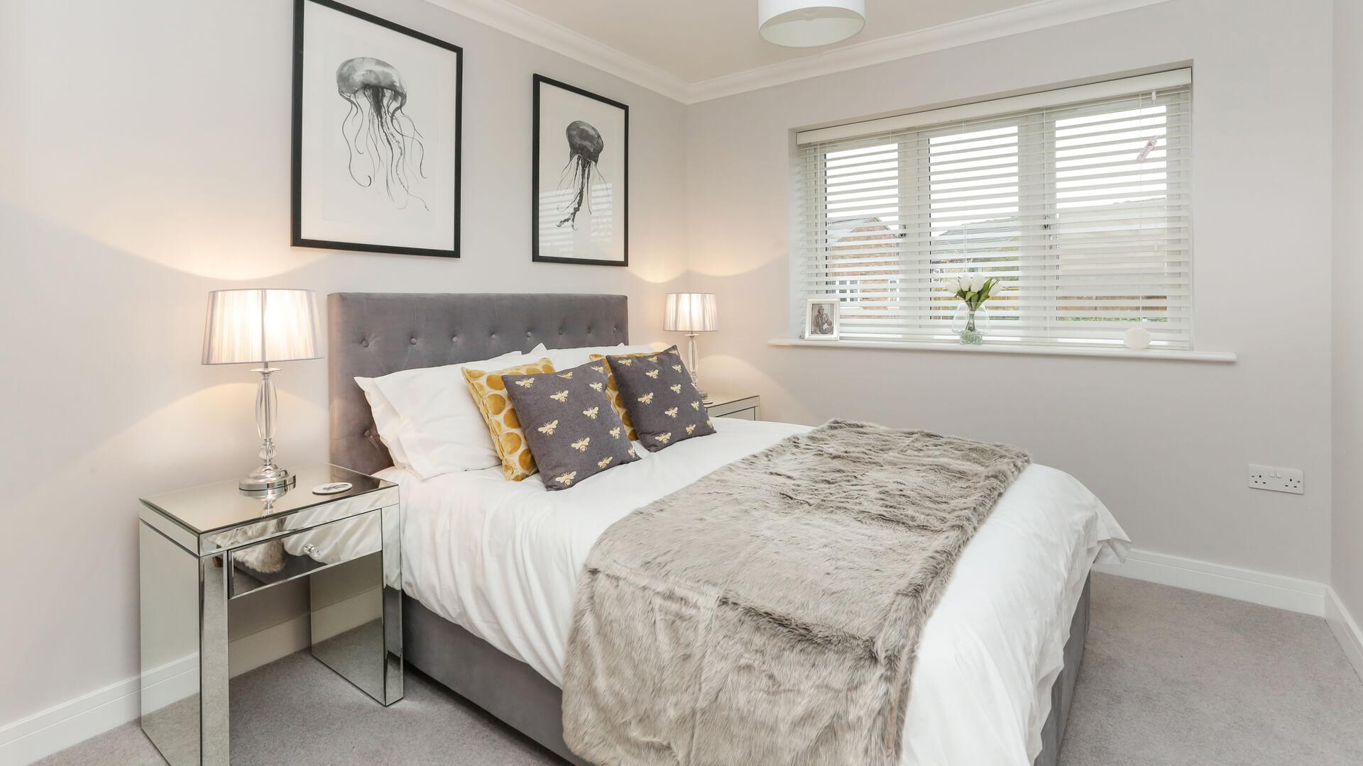 Double bed in dressed bedroom