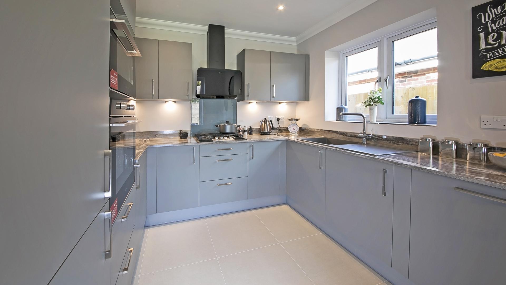 Fitted grey kitchen at Churchfields Plot 1