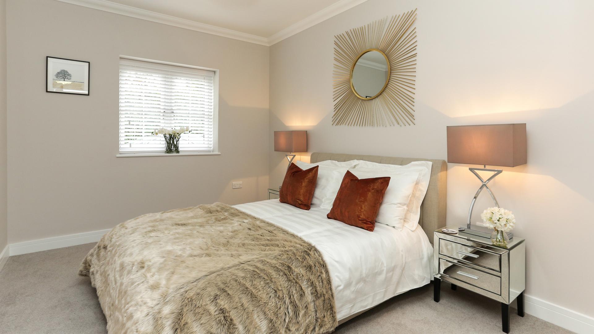 Cobnut Park plot 7 bedroom with fur blanket and neutral walls.