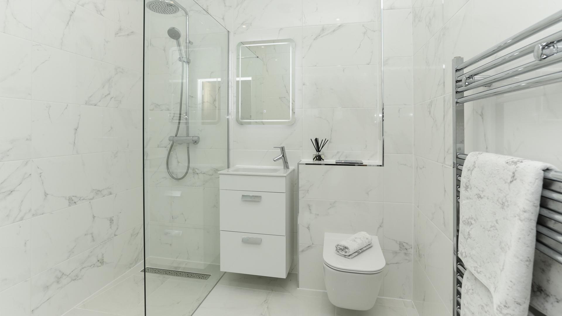 Cobnut Park plot 6 shower room with white Porcelanosa tiles