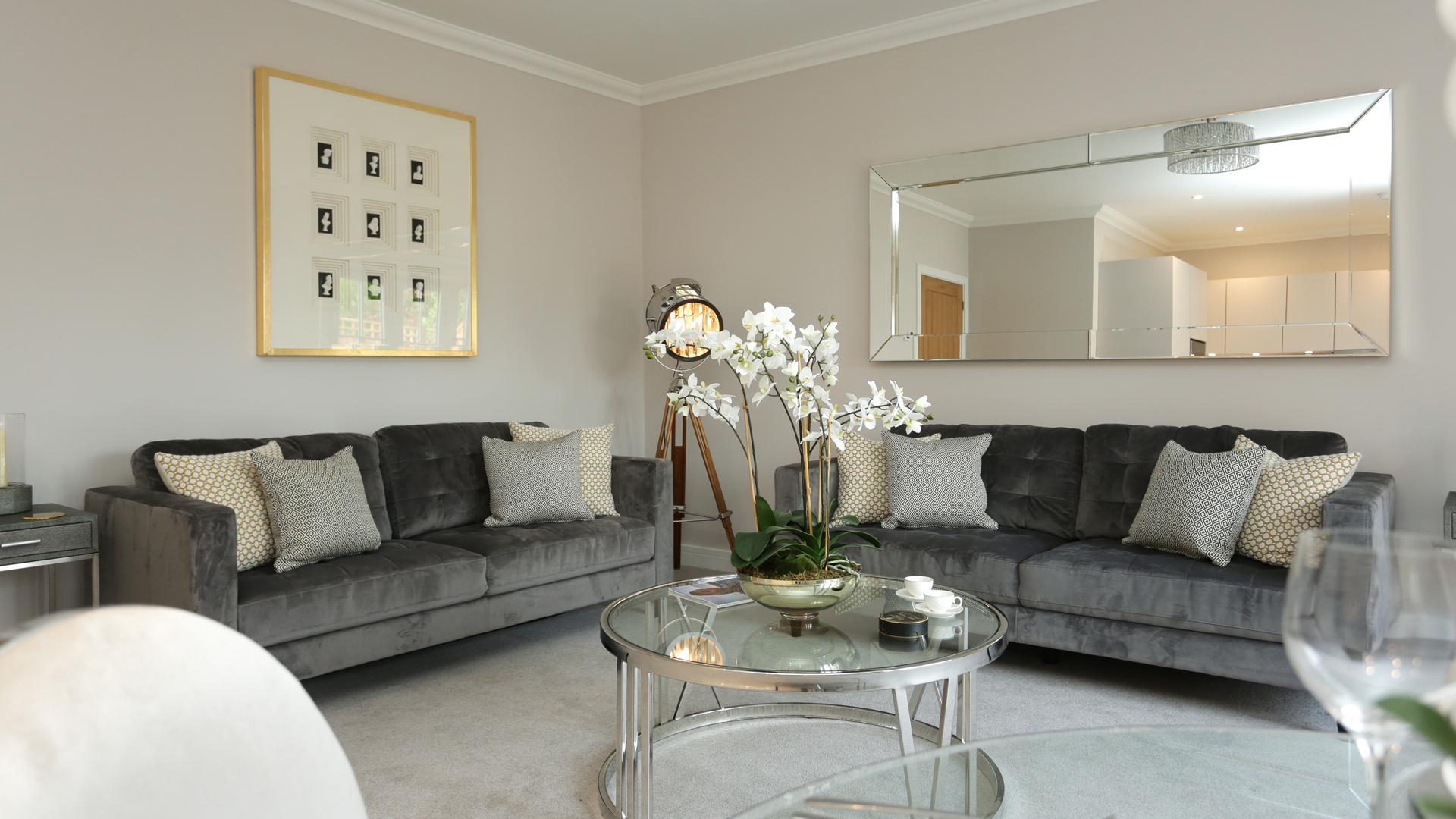 Cobnut Park living room with a mirror, photo and grey sofas.