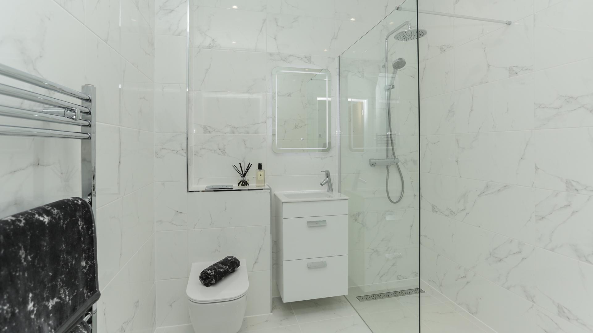Cobnut Park Plot 7 shower room with white Porcelanosa tiles